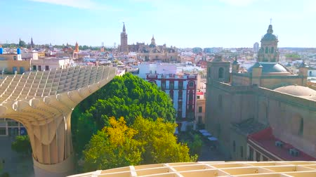 andalucia : SEVILLE, SPAIN - OCTOBER 1, 2019: The view from Metropol Parasol panoramic terrace on the Pantheon of Illustrious Sevillian and Gothic Cathedral with tall Giralda bell tower, on October 1 in Seville
