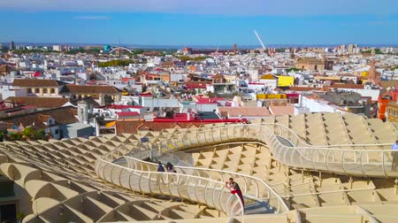 incarnation : SEVILLE, SPAIN - OCTOBER 1, 2019: The curved walkway along the upper terrace of Metropol Parasol (Las setas de la Encarnacion) wooden consctruction, overlooking old town, on October 1 in Seville Stock Footage