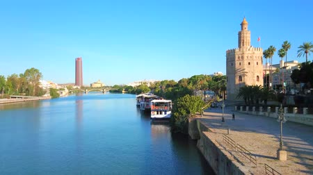 паром : SEVILLE, SPAIN - OCTOBER 2, 2019: Observe Guadalquivir river, Casco Antiguo district, medieval Torre del Oro (Golden Tower) and Torre Sevilla (Seville Tower) on background, on October 2 in Seville