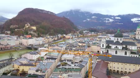 bell tower : SALZBURG, AUSTRIA - MARCH 1, 2019: Watch town panorama from Monchsberg Hill - Hohensalzburg Fortress dominates the skyline and Salzach river divides city into two parts, on March 1 in Salzburg Stock Footage