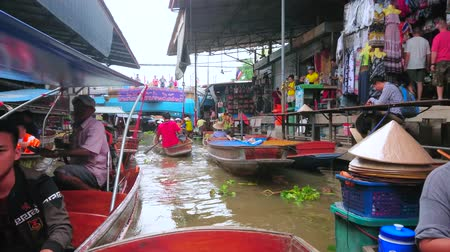 ratchaburi : DAMNOEN SADUAK, THAILAND - MAY 13, 2019: Exotic Ton Khem floating market offers wide range of souvenirs, toys, handicrafts, snacks and local foods, on May 13 in Damnoen Saduak