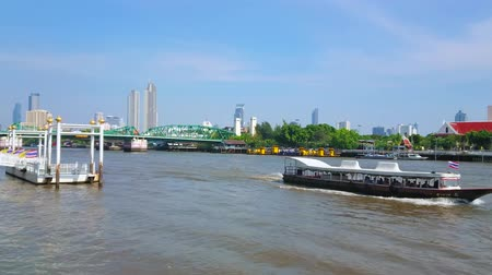 pontoon : BANGKOK, THAILAND - APRIL 23, 2019: Enjoy the modern cityscape from the Yodpiman pier of Chao Phraya river, observing Memorial bridge, floating ships and glass skyscrapers, on April 23 in Bangkok