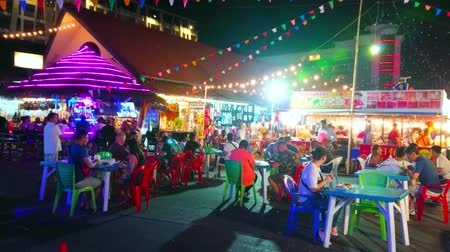 székek : PATONG, THAILAND - MAY 1, 2019: The Otop Market food court with outdoor cafes and street food stalls, offering local cuisine and refreshing drinks, on May 1 in Patong