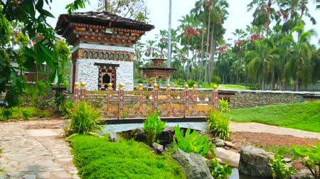 украшенный : The ornate bridge over the small pond and traditional Buddhist shrine, decorated with fine patterns of carved and painted wood in Bhutan garden of Rajapruek Royal Park of Chiang Mai, Thailand