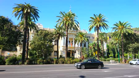 zegar : MALAGA, SPAIN - SEPTEMBER 26, 2019: The scenic Town Hall edifice, facing Cervantes avenue and surrounded with lush palm trees, on September 26 Malaga