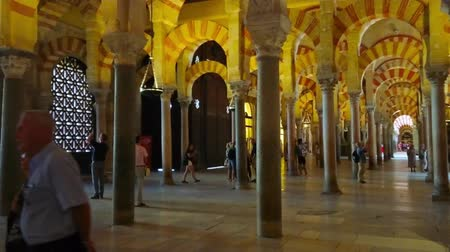 mór : CORDOBA, SPAIN - SEPTEMBER 30, 2019: Explore medieval interior of Mezquita-Catedral (Mosque-Cathedral) with Moorish style arcades and extant antique columns, on September 30 in Cordoba Stock mozgókép