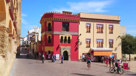 stone : CORDOBA, SPAIN - SEPTEMBER 30, 2019: Historic Moorish style mansions in Plaza del Triunfo (Triumph Square) with ornate tilling, arched windows, decorative battlements, on September 30 in Cordoba