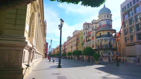 mudejar : SEVILLE, SPAIN - OCTOBER 2, 2019: Constitution Avenue is one of iconic locations of the city with such landmarks as Edificio la Adriatica building, Bank of Spain and Cathedral, on October 2 in Seville Stock Footage
