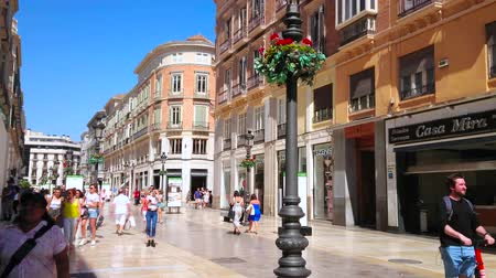 рекламный : MALAGA, SPAIN - SEPTEMBER 26, 2019: The architectural ensemble of Calle Larios - the famous pedestrian street of resort with fashion boutiques, large stores and cafes, on September 26 in Malaga