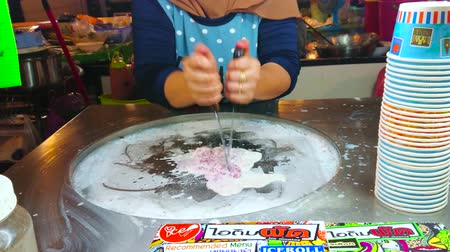 adil : AO NANG, THAILAND - APRIL 27, 2019: Preparing of tasty ice rolls (dondurma) with fruits and berries in outdoor stall of Ao Nang Night Market, on April 27 in Ao Nang