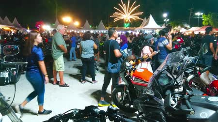 adil : AO NANG, THAILAND - APRIL 27, 2019: Ao Nang Bike Week attracts tourists and locals to visit this event, helding next to the Night Market and Amusement park, on April 27 in Ao Nang Stok Video