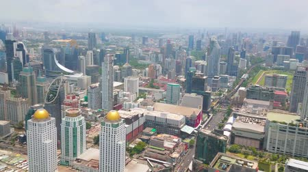 pathum wan : BANGKOK, THAILAND - APRIL 24, 2019: Birds eye panorama of business district with forest of modern skyscrapers from the roof of Baiyoke Tower II in New Town, on April 24 in Bangkok
