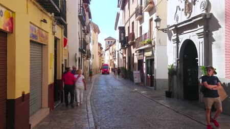 mouro : GRANADA, SPAIN - SEPTEMBER 27, 2019: Walk the narrow Carrera del Darro street of Albaicin district, lined with medieval mansions (casa), convents, tourist shops and cafes, on September 27 in Granada