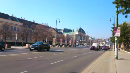 tramwaj : VIENNA, AUSTRIA - FEBRUARY 17, 2019: The fast traffic along Museumsplatz (square), lined with classic mansions, museums and with a view on Volkstheater theatre on background, on February 17 in Vienna