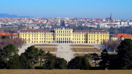 schonbrunn : VIENNA, AUSTRIA - FEBRUARY 19, 2019: The scenic skyline from the top of  Schonbrunn hill, observing lush greenery of Great Parterre garden and palace at the hills foot, on February 19 in Vienna