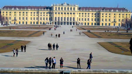 schonbrunn : VIENNA, AUSTRIA - FEBRUARY 19, 2019:  The tourists walk the alleys of Grand Parterre ornamental garden of Schonbrunn palace, on February 19 in Vienna.