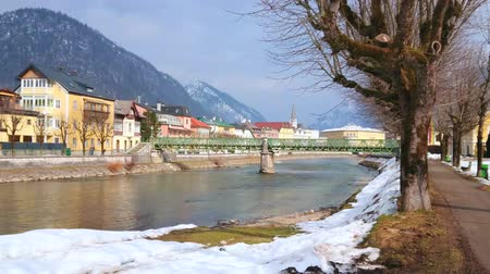 The nice park along the Traunkai embankment of Traun river with a view on Taubersteg bridge and architecture of Bad Ischl, Salzkammergut, Austria