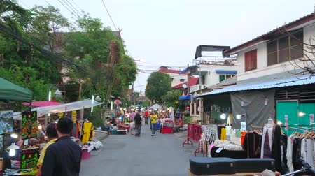 veter : CHIANG MAI, THAILAND - MAY 4, 2019: Wualai walking street is lined with Saturday Night Market stalls, offering local designer clothes, souvenirs, accessories and handicrafts, on May 4 in Chiang Mai