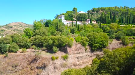 mudejar : Panorama of Generalife gardens of Alhambra, occupying the Cerro del Sol (Hill of Sun) and the medieval white housing of historical Sacromonte and Albaicin districts of Granada on background, Spain