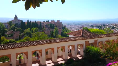 mudejar : GRANADA, SPAIN - SEPTEMBER 25, 2019: Panorama of the Patio of Irrigation Ditch and Generalife gardens with Alhambra fortress on SAbika hill on the background, on September 25 in Granada