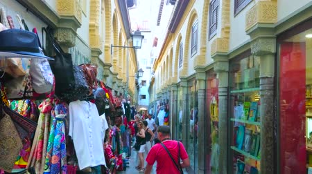 iberian : GRANADA, SPAIN - SEPTEMBER 25, 2019: Calle Alcaiceria market is former Arabic Grand Bazaar, attracting people with different souvenirs, handicrafts, garment and accessories, on September 25 in Granada Stock Footage
