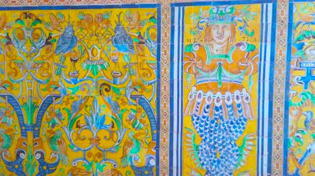 mór : SEVILLE, SPAIN - OCTOBER 1, 2019: Stunning vintage tilling on the wall of Alcazar Palace with Andalusian pattern, including flora and fauna motifs, fauns and traceries, on October 1 in Seville