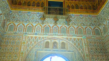 mudejar : SEVILLE, SPAIN - OCTOBER 1, 2019: Impressive Ambassadors Hall of King Pedro I Palace with ornate tilling, mocarabe dome, sebka designs, arabesques, carvings and gilt details, on October 1 in Seville