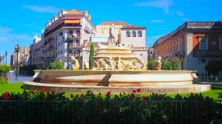 iberian : SEVILLE, SPAIN - OCTOBER 1, 2019: The beautiful Fuente de Hispalis fountain, located in Jerez Gate square and surrounded by historical mansions and Cristina Gardens, on October 1 in Seville