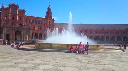 mudejar : SEVILLE, SPAIN - OCTOBER 1, 2019: Explore outstanding Plaza de Espana square with iconic Andalusian architecture and big fountain amid pedestrian area, on October 1 in Seville