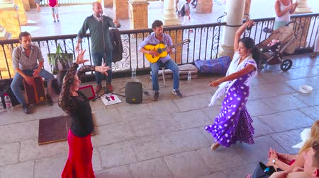 mudejar : SEVILLE, SPAIN - OCTOBER 1, 2019: Performance of professional flamenco dancers in Plaza de Espana, artists entertain and invite tourists to evening flamenco show, on October 1 in Seville
