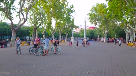 crepúsculo : SEVILLE, SPAIN - OCTOBER 1, 2019: La Alameda square with large pedestrian area is one of the most beloved places for evening walks and the fine meeting point among cyclists, on October 1 in Seville