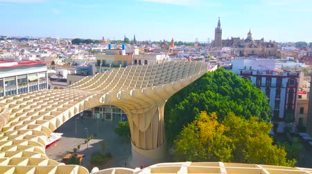 iberian : SEVILLE, SPAIN - OCTOBER 1, 2019: Panorama of Metropol Parasol terrace, Pantheon of Illustrious Sevillians and Gothic Cathedral with tall Giralda bell tower, on October 1 in Seville Stock Footage
