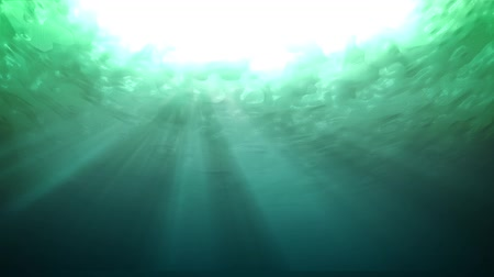 emerald green : Underwater of green with light rays. Wave come and ripple. Seamless loop. Stock Footage