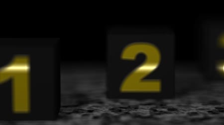 hodnost : Three building blocks of black with gold number on black marble.