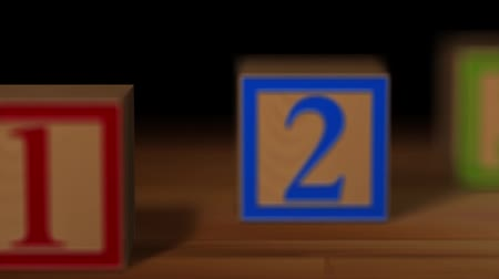 hodnost : Three building blocks of wood with colorful number on wood. Dostupné videozáznamy