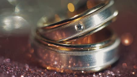háttérrel : Wedding rings lying on on light surface