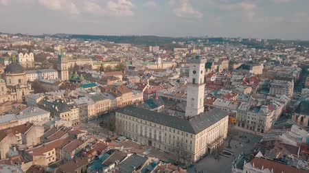 prag : Ukraine Lviv City Council, Town Hall, the tower. Panorama of the ancient city. The roofs of old buildings. Streets Aerial. Stok Video