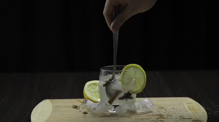 tonik : Mix with a spoon lemon cocktail. Refreshing alcoholic cocktail drink.