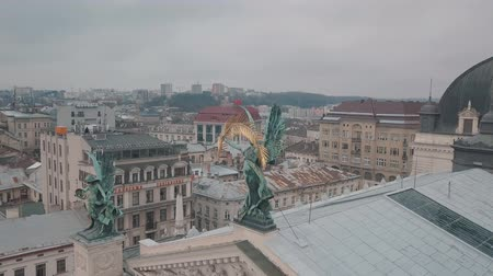 guildhall : Aerial Old City Lviv, Ukraine. Central part of old city. European City. Densely populated areas of the city. Statue of Glory on the facade of the Lviv Opera. Panorama of the ancient town Stock Footage