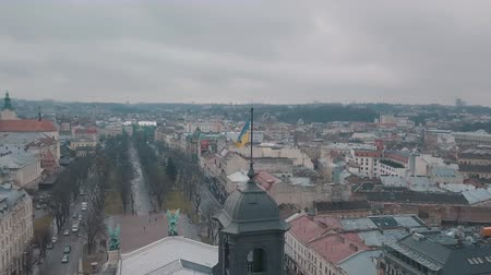 városháza : Aerial Shot Ukrainian Flag Flying on Top of Lviv Opera. Central part of old European city. Densely populated areas of the city. Panorama of the ancient Lvov town