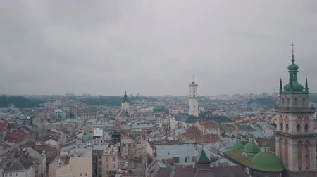 dominican : Aerial Roofs and streets Old City Lviv, Ukraine. Central part of old city. European City. Densely populated areas of the city. Panorama of the ancient town. Church Stock Footage