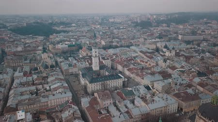 guildhall : Aerial Roofs and streets Old City Lviv, Ukraine. Central part of old city. European City. Densely populated areas of the city. Panorama of the ancient town. Ukraine Dominican Stock Footage