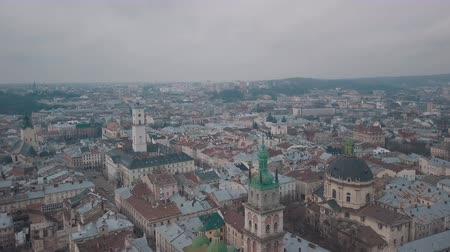 ковер : Aerial Roofs and streets Old City Lviv, Ukraine. Central part of old city. European City. Densely populated areas of the city. Panorama of the ancient town. Ukraine Dominican Стоковые видеозаписи
