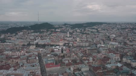 városháza : Aerial Old City Lviv, Ukraine. Central part of old city. European City. Densely populated areas of the city. Town hall, Ratush, Opera, Dominican church. Lviv central 4k ultrahd Stock mozgókép