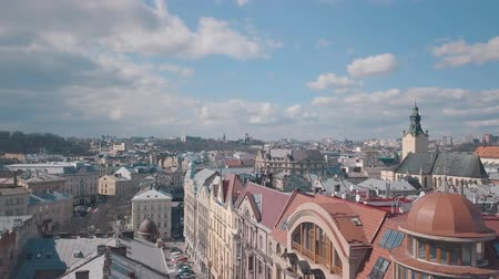 dominican : Lviv, Ukraine. March 20, 2019: Aerial Roofs and streets Old City Lviv, Ukraine. Central part of old city. European City. Densely populated areas of the city. Panorama of the ancient town. Rooftops