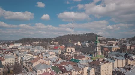 guildhall : Lviv, Ukraine. March 20, 2019: Aerial Roofs and streets Old City Lviv, Ukraine. Central part of old city. European City. Popular areas. Panorama of the ancient town. Rooftops. Dominican Church
