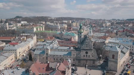 dominican : Lviv, Ukraine. March 20, 2019: Aerial Roofs and streets Old City Lviv, Ukraine. Central part of old city. European City. Popular areas. Panorama of the ancient town. Rooftops. Church of St. Andrew