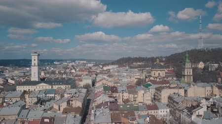 lviv : Lviv, Ukraine. March 20, 2019: Aerial Roofs and streets Old City Lviv, Ukraine. Central part of old city. European City. Popular areas. Panorama of the ancient town. Town Hall. Dominican Church