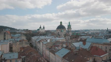 városháza : Lviv, Ukraine. March 20, 2019: Aerial Roofs and streets Old City Lviv, Ukraine. Dominican Church. Central part of old city. European City. Popular areas. Panorama of the ancient town. Rooftops