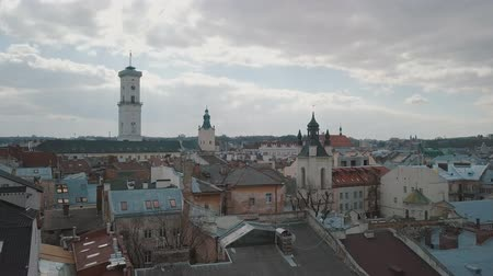 lviv : Lviv, Ukraine. March 20, 2019: Aerial Roofs and streets Old City Lviv, Ukraine. Central part of old city. European City. Popular areas. Panorama of the ancient town. Rooftops. Town Hall Stock Footage